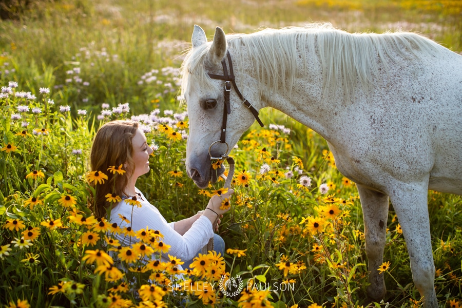 High School Senior Girl with Horse in flowers