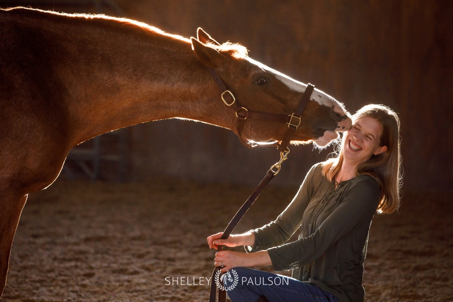 Photo of a horse kissing a woman