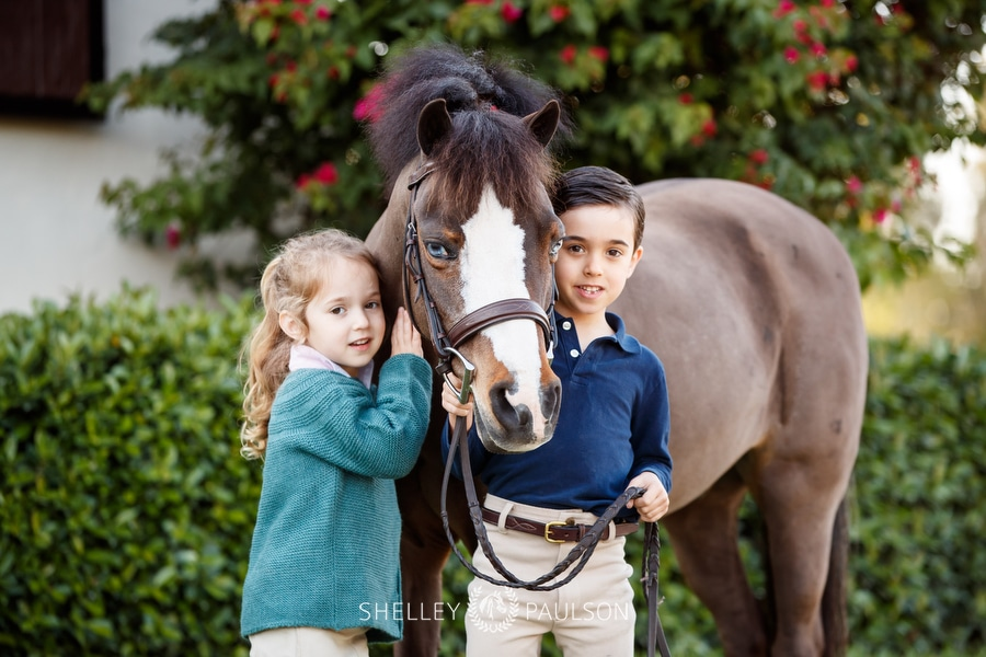 portrait of two kids and their pony