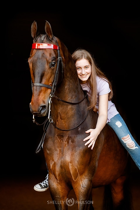 High School Senior Hugging Horse